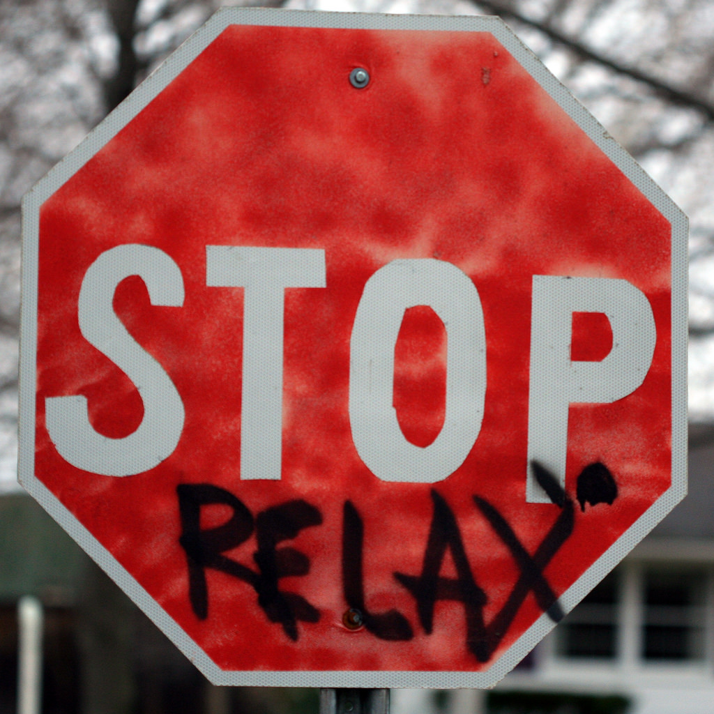 stop sign with relax spray painted on in black